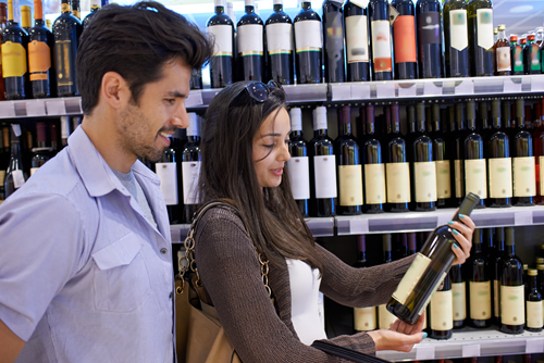Customers shopping for wine at a retail store