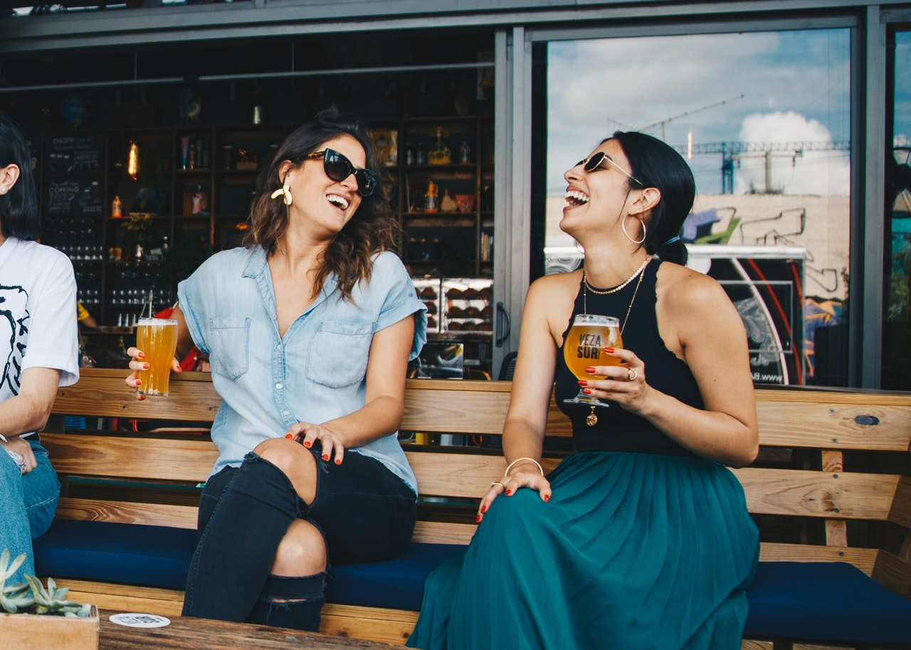 Women drinking beer on a patio photo for brand relevant email